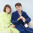 Young happy couple drinks sparkling wine — Stock Photo