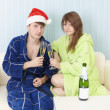Happy couple in dressing gowns drinks sparkling — Stock Photo #2349491