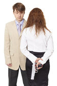 Young man and the woman armed with a pistol — Stock Photo