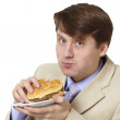 Young businessman is the dinner isolated on whit — Stock Photo
