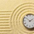 Old watch on surface of golden sand - Stock Photo