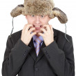 Stock Photo: Emotional comical Russimin fur hat