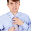 One young man arranges his tie — Stock Photo