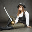Woman - captain of pirates sitting — Stock Photo