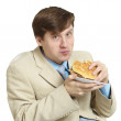 Funny businessman eats a sandwich isolated on a — Stock Photo