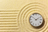 Old watch on surface of golden sand — Stock Photo