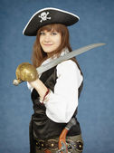 Beautiful woman in clothes of pirate on blue bac — Stock Photo