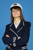 Portrait of the proud woman - captain on blue — Stock Photo