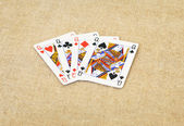 Playing cards queens of different suits — Stock Photo