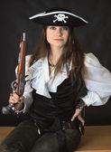 Beautiful girl - sea pirate with pistol — Stock Photo