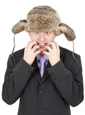 Emotional comical Russian man in fur hat — Stock Photo
