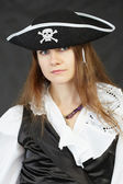 Woman pirate on a black background — Stock Photo