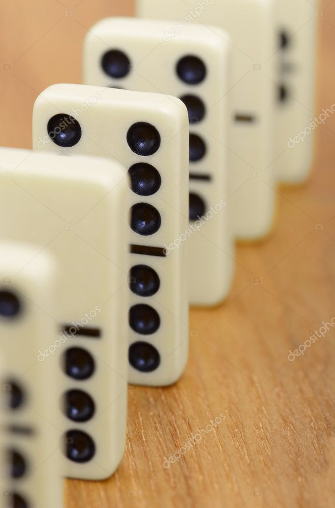Dominoes bones on a wooden surface abreast — Stock Photo #2354163