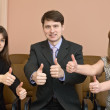Team of businessmen show thumb — Stock Photo