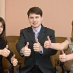 Team of businessmen show thumb — Stock Photo