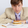 Man in a light jacket and big sandwich — Stock Photo