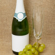 Bottle of sparkling wine, glass, grapes — Stock Photo