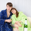 Young couple in dressing gowns - Stock Photo