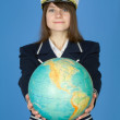 Girl in sea uniform with globe — Stock Photo