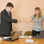 Handshake men and young women — Stock Photo