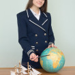 Girl in seuniform with geographic glob — Stock Photo #2366473