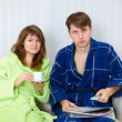 Couple sit on sofa and watching TV — Stock Photo