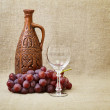Still-life - clay bottle, grapes a glass - Foto de Stock  