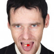 Young man eats a pill put it on tongue — Stock Photo