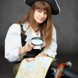 Royalty-Free Stock Photo: Girl - pirate sitting with a map