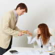 Man treats woman colleague hamburger — Stock Photo