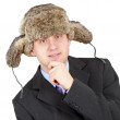 Man in a fur hat on white background — Stock Photo