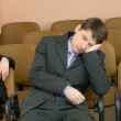 Businessman has fallen asleep at confere — Stock Photo