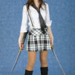 Stock Photo: Girl in skirt armed with two katana