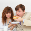 Royalty-Free Stock Photo: Secretary is feeding his boss