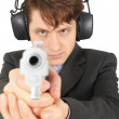 Businessman aiming a gun — Stock Photo