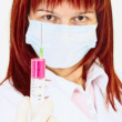 Young woman doctor with syringe in hand — Stock Photo #2373104
