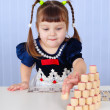 Little girl playing with toys on table — Stock Photo