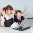 Daughter and mother playing with laptop — Stock Photo