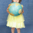 Little girl holding a large globe — Stock Photo #2374735