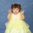 Little girl in beautiful dress claps — Stock Photo