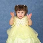 Little girl in beautiful dress claps — Stock Photo