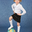 Girl set foot on globe like a ball — Stock Photo