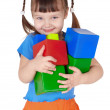 Little happy girl with toys in hands - Stock Photo