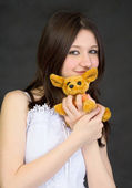 Portrait of teenage girl with toy — Stock Photo