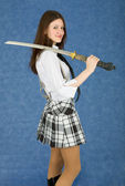 Girl teenager armed with Japanese sword — Stock Photo
