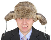 Angry Russian businessman in fur hat — Stock Photo