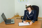 Woman in uniform sailor in office — Stock Photo