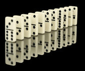 Dominoes ranked on black — Stock Photo