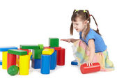Girl playing with color toys — Stock Photo