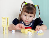Child playing with small toys at table — Stock Photo